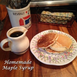 Homemade Maple Syrup next to pancakes on plate
