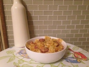 Sausage Pasta in white bowl with sausage sitting on top