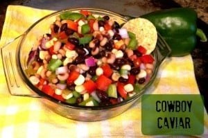 Cowboy Caviar in clear round sigh with chip sticking out of salsa