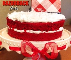 Frosted Razorback Cake on white cake stand with red bow
