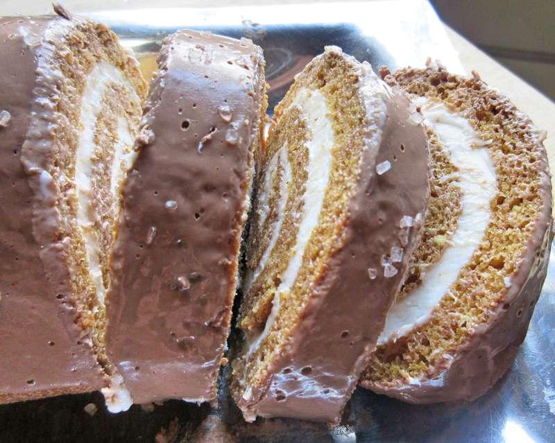 Overhead photo of sliced cake roll on silver platter