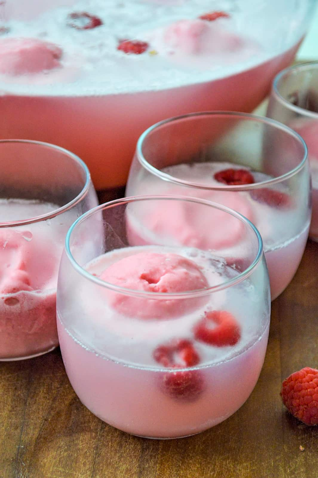 Close up of Punch in glass with raspberries