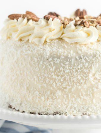 square image of italian cream cake on cake stand