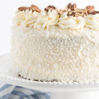 italian cream cake on cake stand decorated