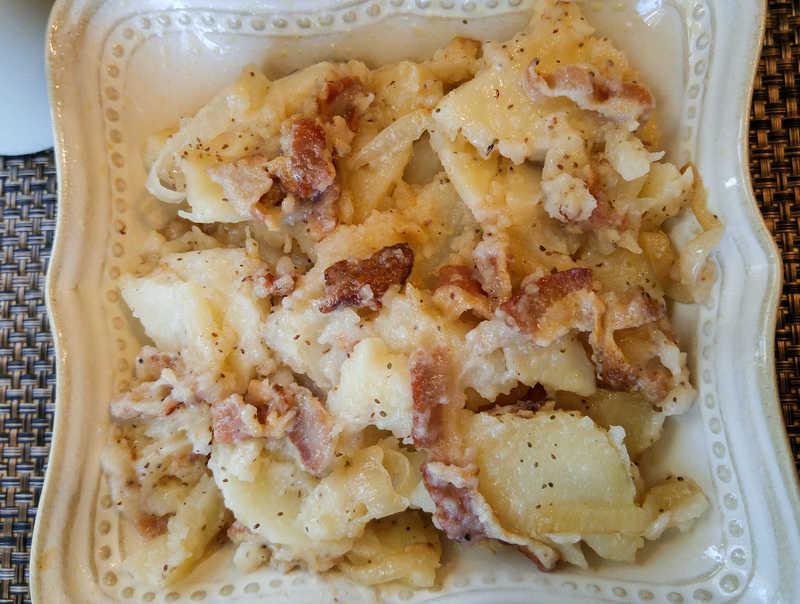 Overhead of Hot German Potato Salad in cream square bowl