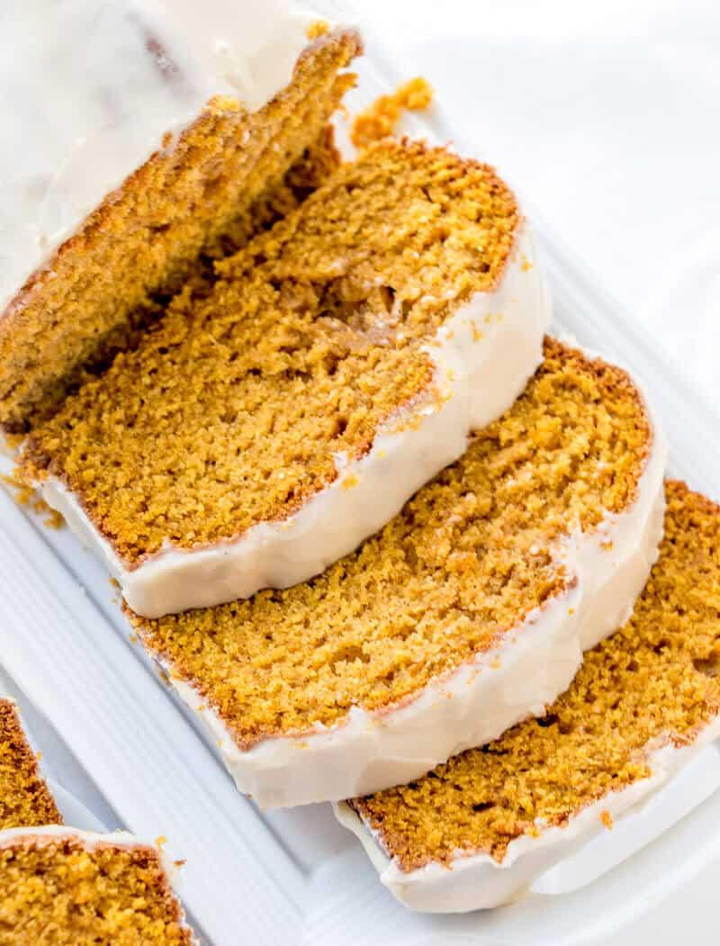 Overhead of sliced pumpkin bread fanning off loaf