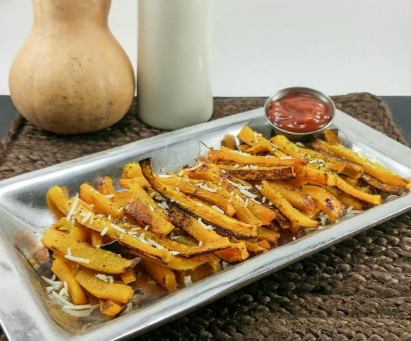 Squash fries on silver serving platter topped with parmesan and side of ketchup