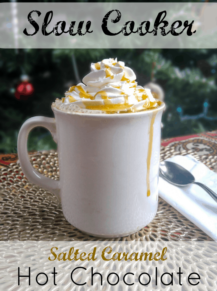 Salted Caramel Hot Chocolate in white mug topped with whipped cream and drizzled in caramel