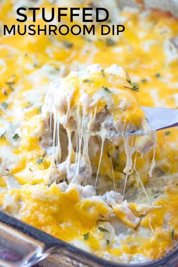 Pinterest image of stuffed mushroom dip with knife showing cheese pull