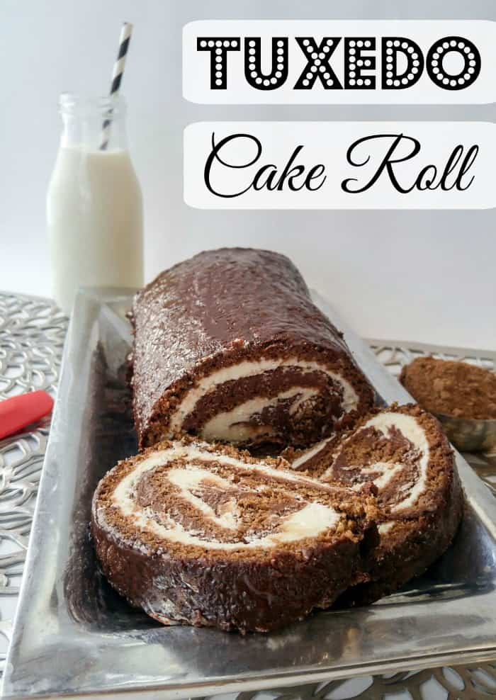 Tuxedo Cake Roll on silver platter with two slices cut from roll