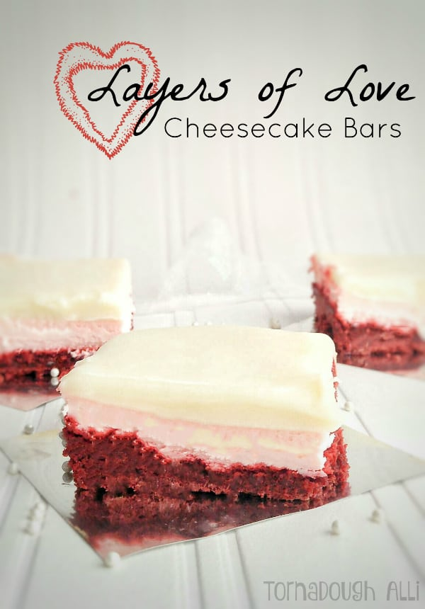 Layers of Love Cheesecake Bars on silver paper