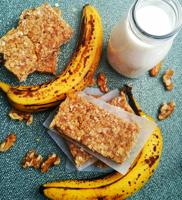 Chewy Banana Nut Granola Bars overhead with ripe bananas and walnuts