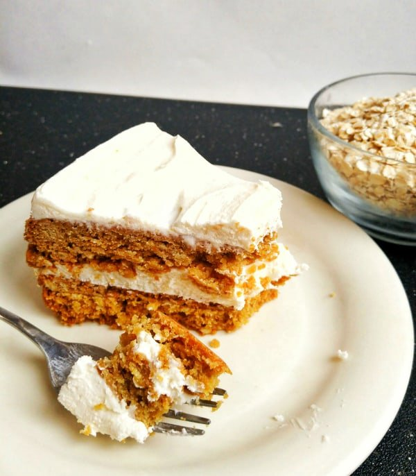 Oatmeal Cream Pie Cookie Cake slice on plate with fork holding bite out