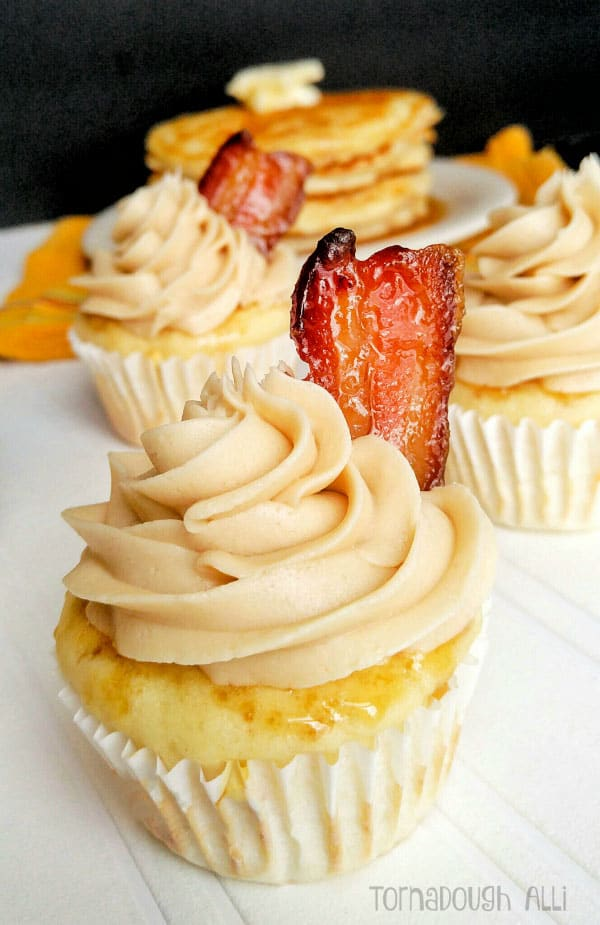Pancake Cupcakes topped with maple buttercream and candied bacon slice