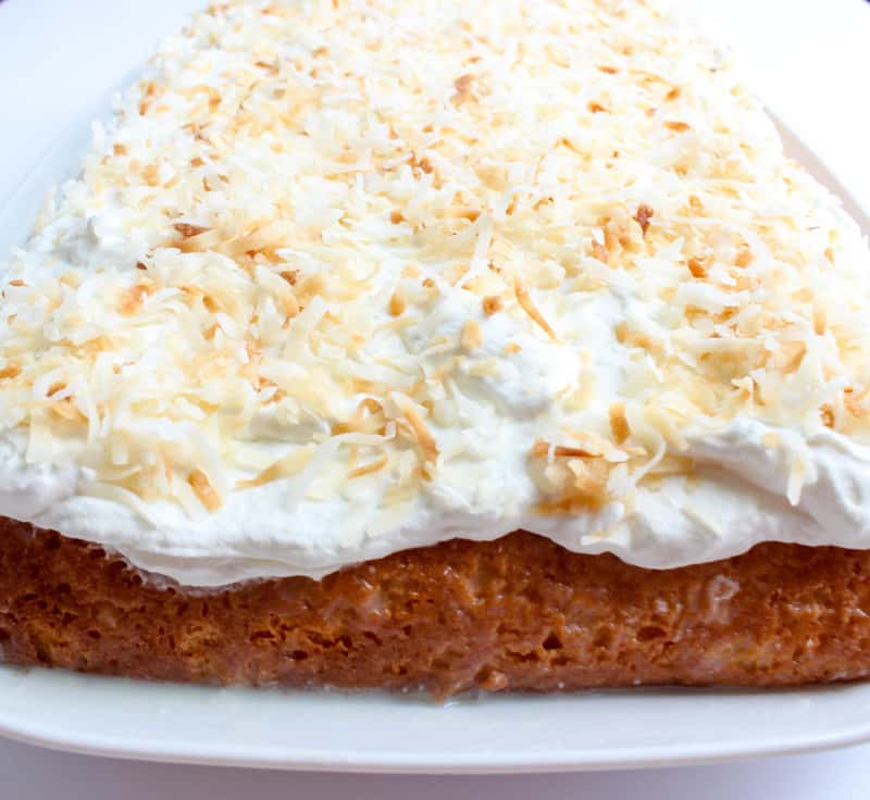 Finished caked on serving tray topped with toasted coconut