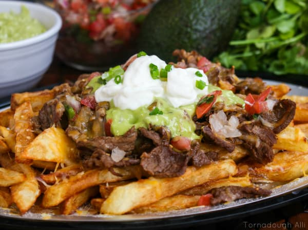 Carne Asada Fries topped with guacamole, pico de Gallo and sour cream