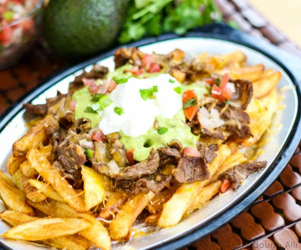 Overhead of Carne Asada Fries on silver platter