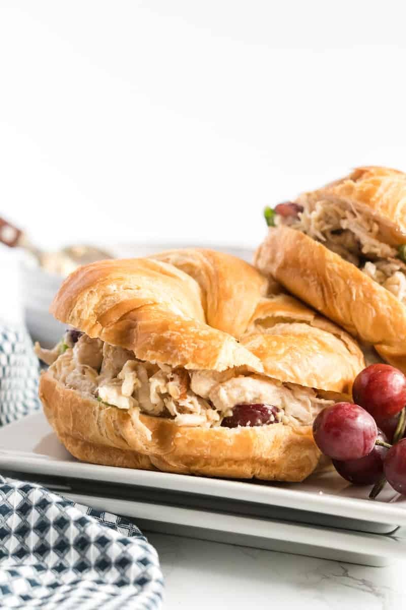 Side view of chicken salad on croissants
