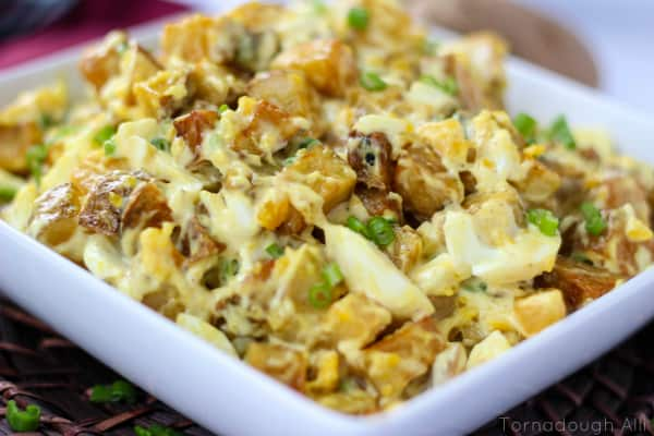 Deep Fried Potato Salad in square dish topped with green onions