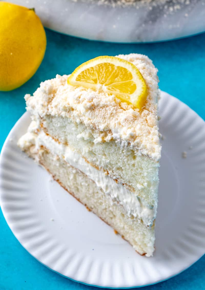 Lemon Crumb Cake on plate with slice of lemon on top