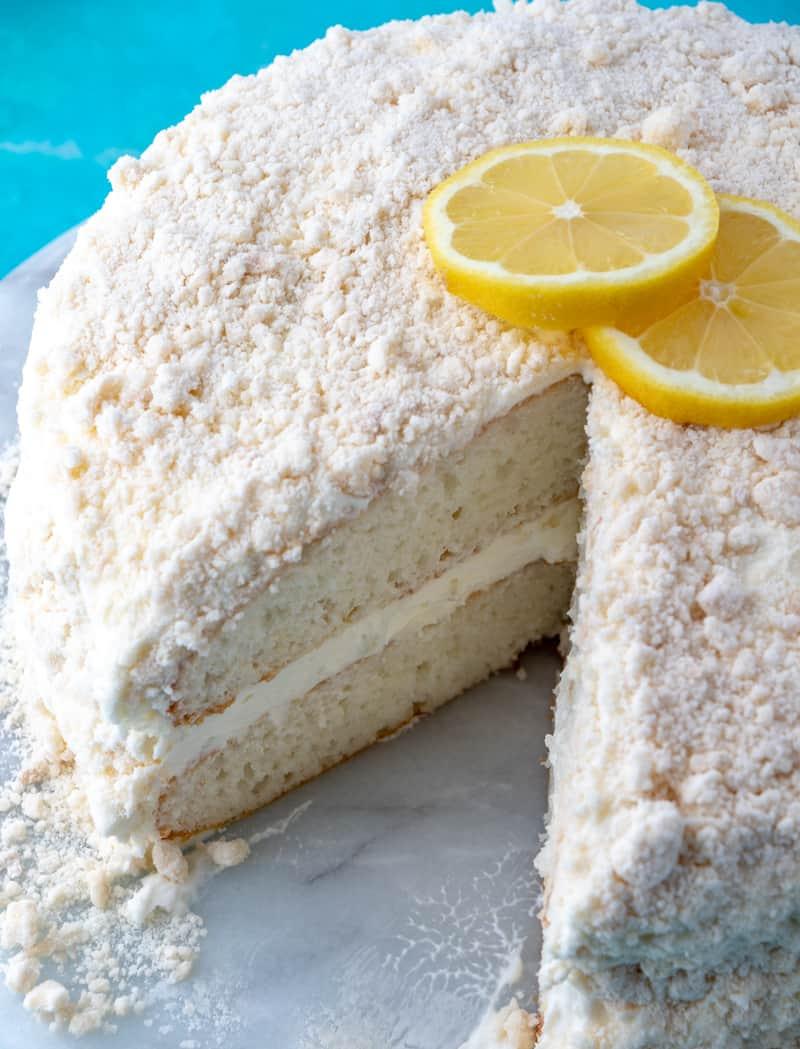 Lemon Crumb Cake, whole cake on turntable with slice missing