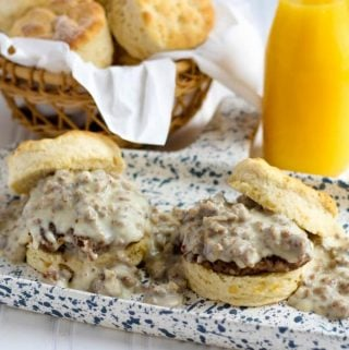 Two Biscuits and Gravy on white and blue speckled plate