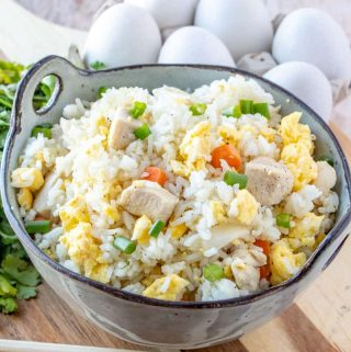 Bowl served with rice with chopsticks and eggs