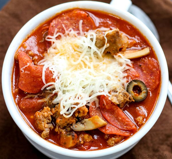 Overhead of Chili in bowl with cheese showing meats and vegetables