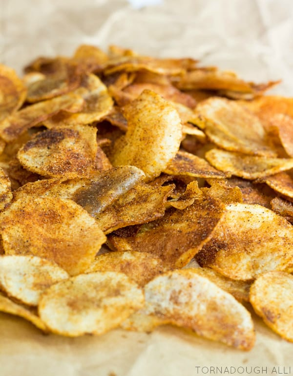 Close up of Homemade BBQ Potato Chips on parchment paper