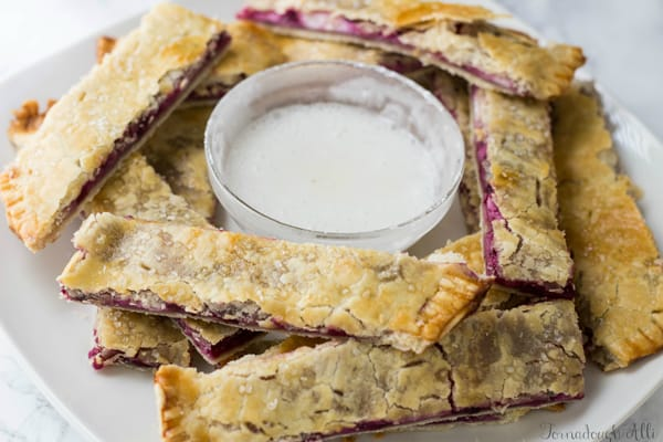 Blackberry Cream Cheese Pie Dippers on plate with dipping sauce in middle