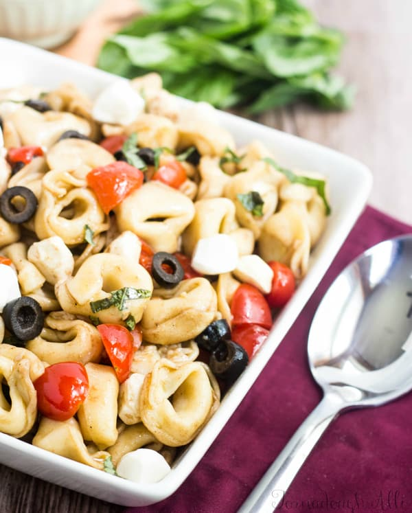Close up of Caprese Tortellini Salad in square serving dish