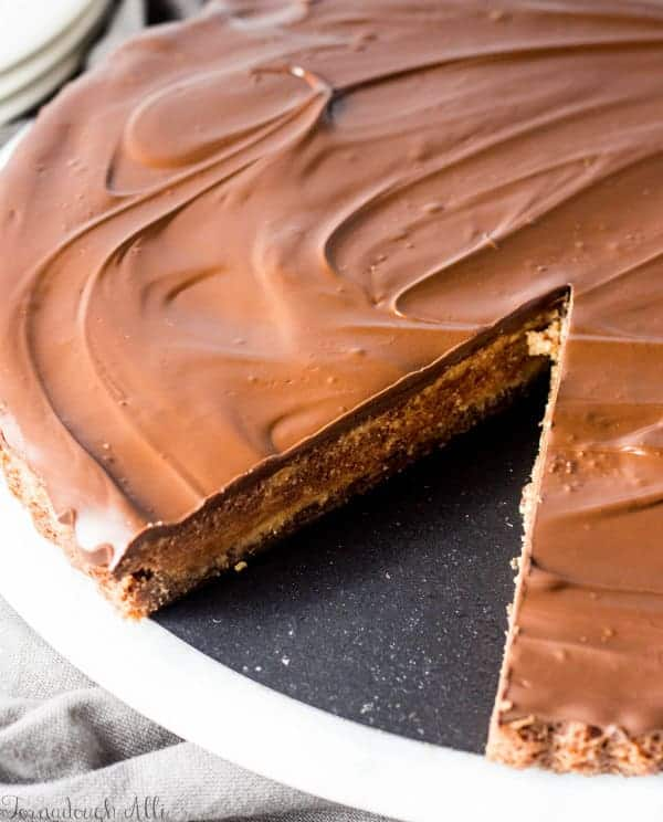 Brownie Bottom Peanut Butter Cup Tart with slice missing