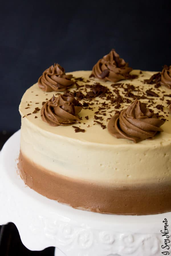 Irish Coffee Chocolate Cake on cake stand showing chocolate swirls and chocolate shavings