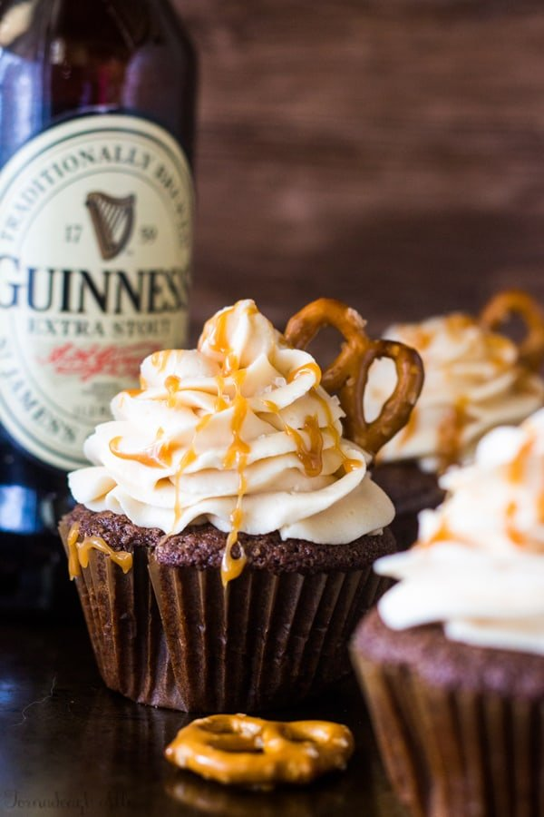 Chocolate Stout Pub Cupcakes next to a bottle of Guinness beer