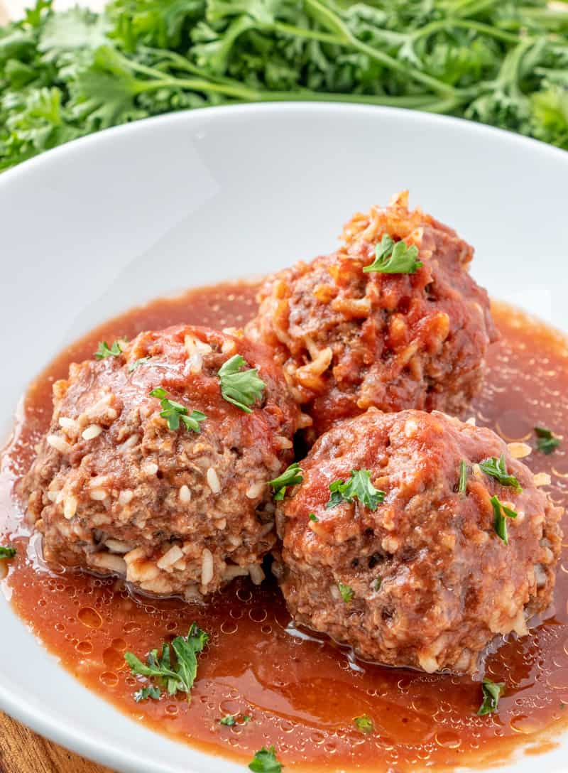 Porcupine Meatballs on plate in gravy