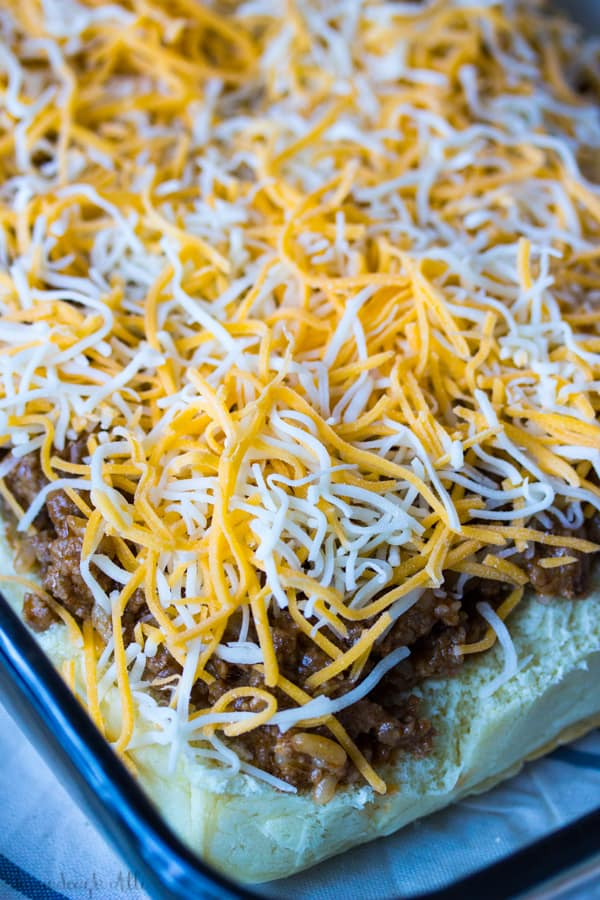 Cheese on top of sloppy Joe mix in pan