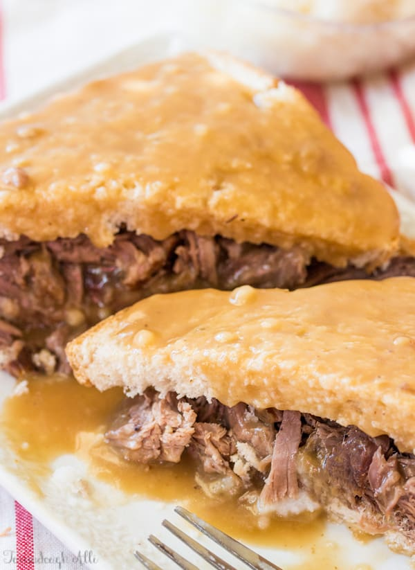Two slices of Roast Beef Commercial on plate covered with gravy