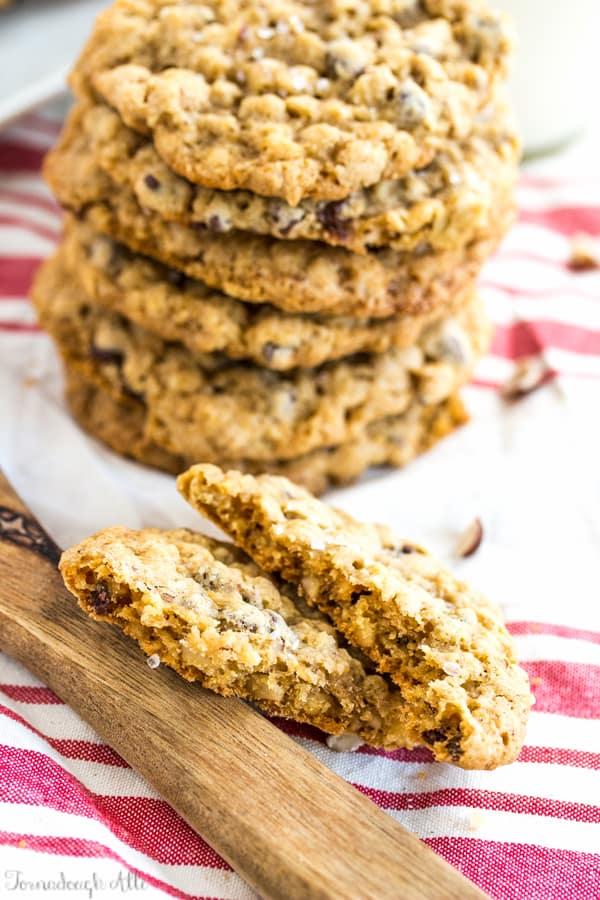 One Sea Salt Hazelnut Chocolate Chip Oatmeal Cookie split in half