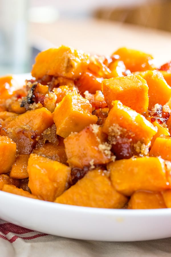 Brown Sugar Bacon Roasted Sweet Potatoes in white bowl