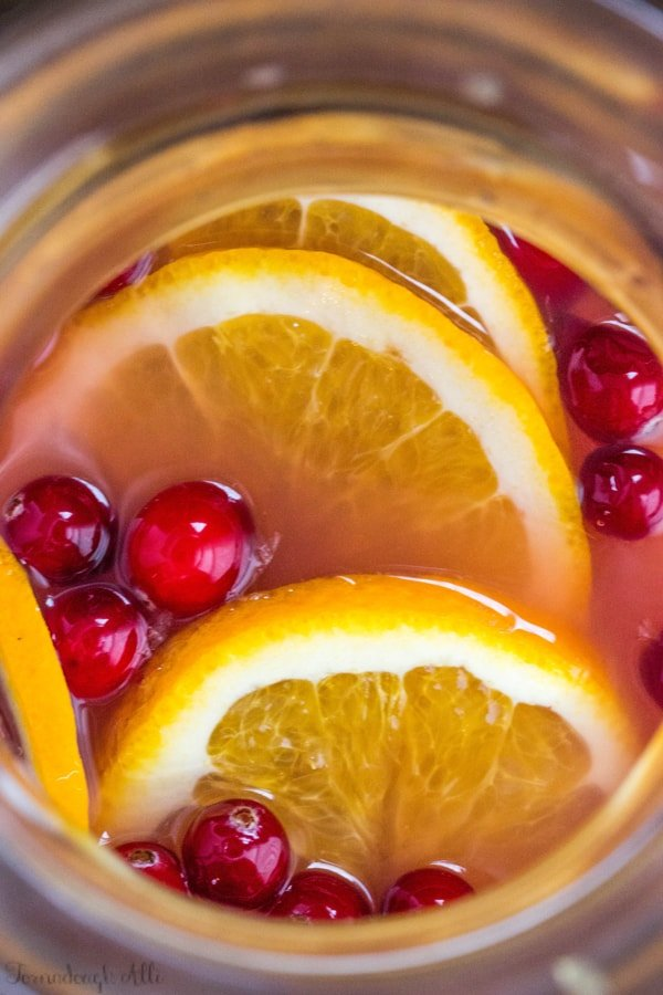 Overhead of Cranberry Orange Mimosas in pitcher