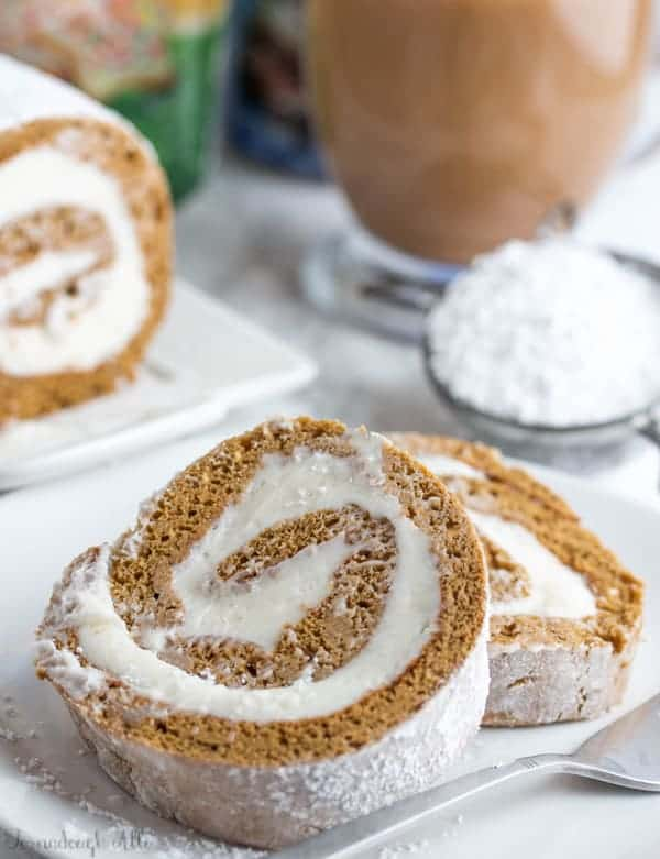 Two slices of Gingerbread Roll on white plate