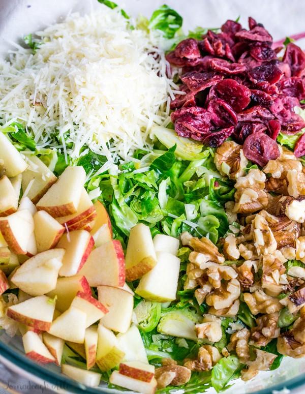 Ingrediens for Shredded Brussel Sprout Harvest Salad in bowl