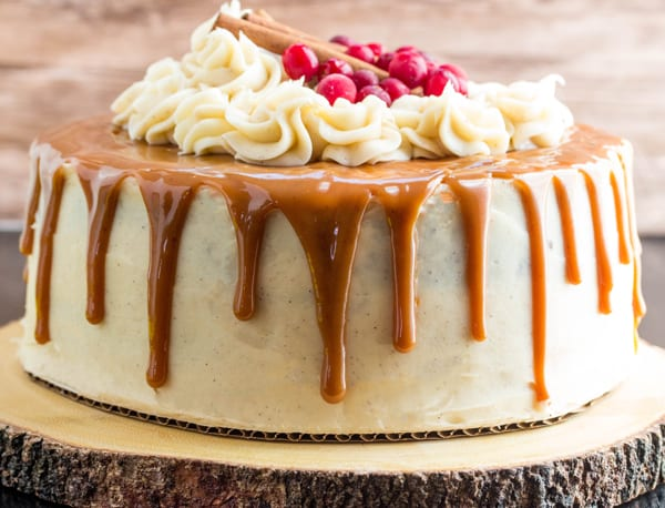 Gingerbread Cake on wooden round with caramel dripping down