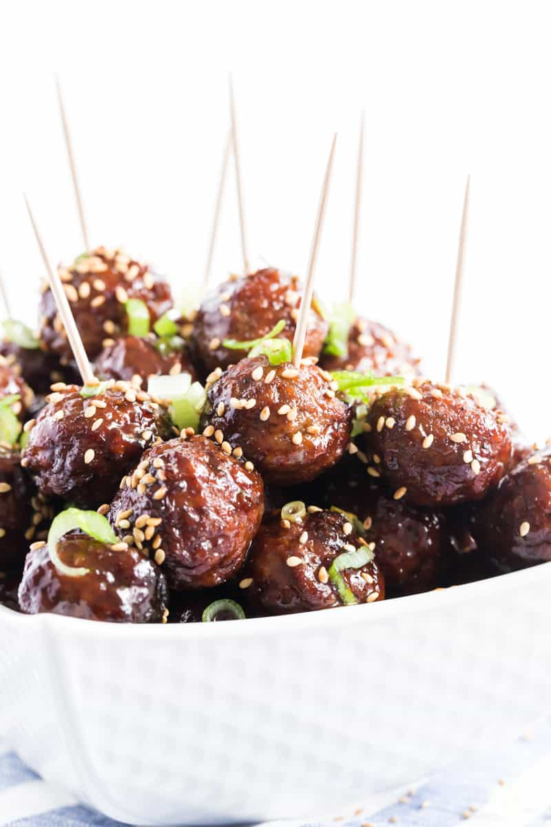 Close up photo of meatballs with toothpicks ready to be served