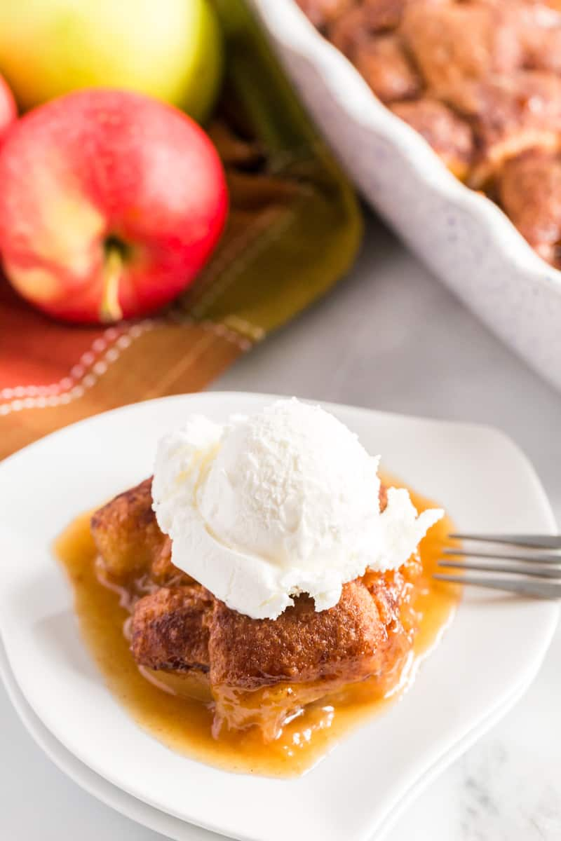 Overhead photo of apple dumpling recipe on plate with ice cream dripping in sauce