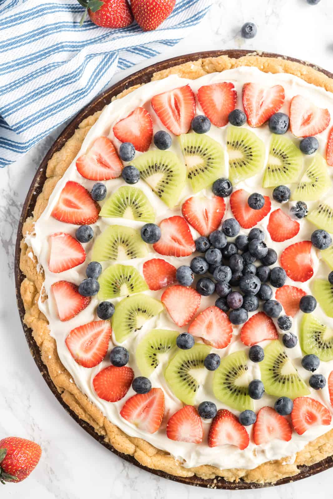 Overhead photo of decorated Fruit Pizza on pizza pan