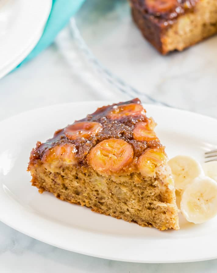 Plated slice of banana upside down cake with caramelized bananas on top
