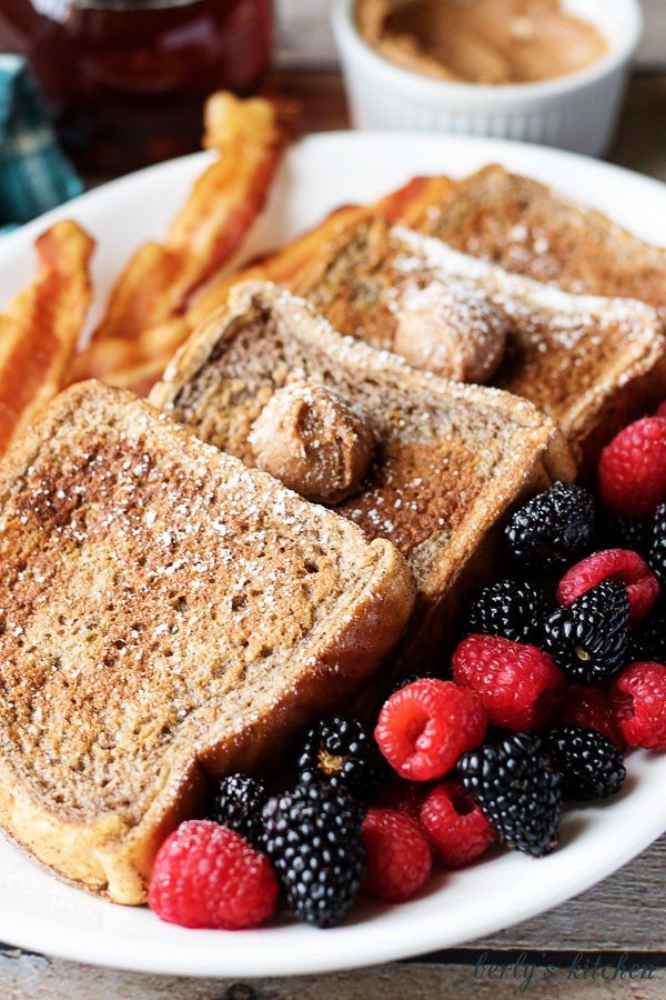 This French toast with cinnamon and brown sugar butter recipe is not your average breakfast! It's loaded with sweet spices and decadent flavored butter.