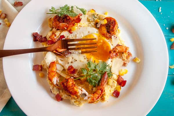 This Spiced Shrimp and Creamy Polenta is a classed-up version of the classic Shrimp and Grits. With roasted corn and topped with a fried egg, this dish is comfort food to the max.