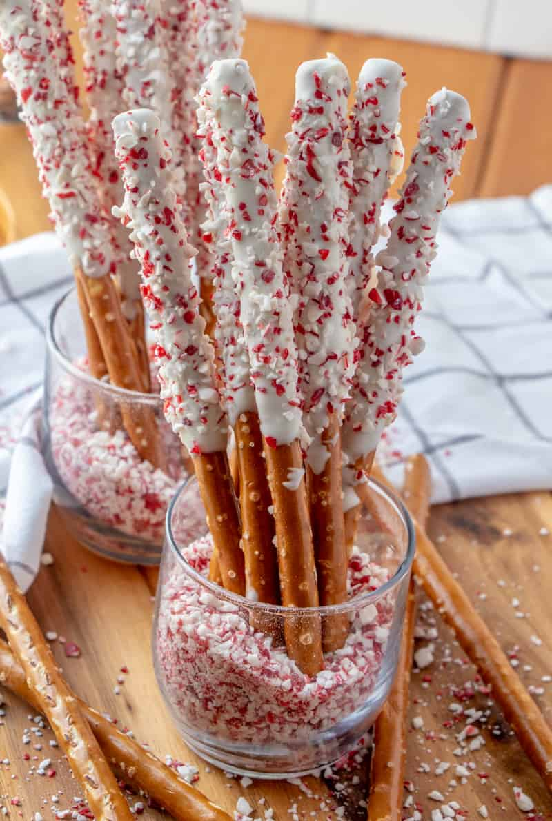 Pretzel Rods in jars filled with crushed candy canes